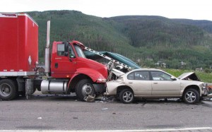 A photo of a rear-end collision between a semi truck and a passenger car.